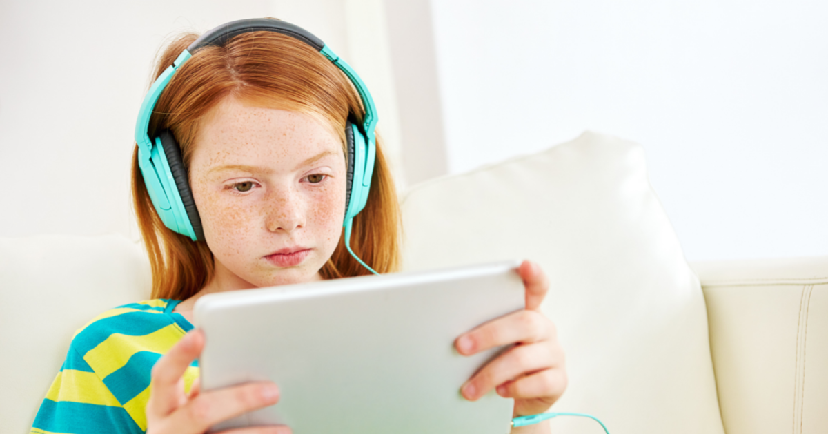 Girl using table with headphones